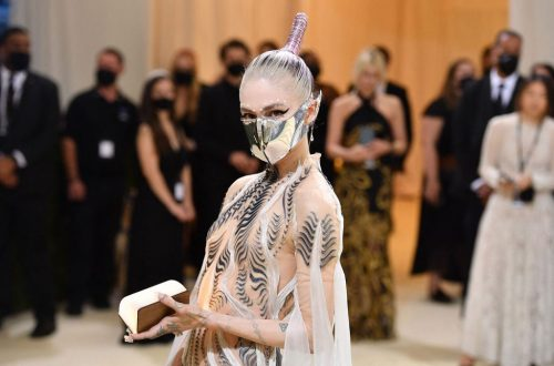 Grimes Says She Trolled Paparazzi by Staging Photo of Herself Reading Karl Marx